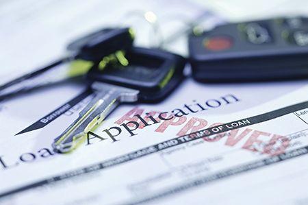 loan application form and car keys