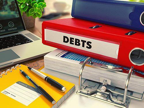 debts written on a folder