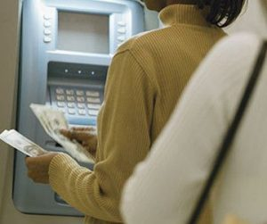 woman withdrawing from atm